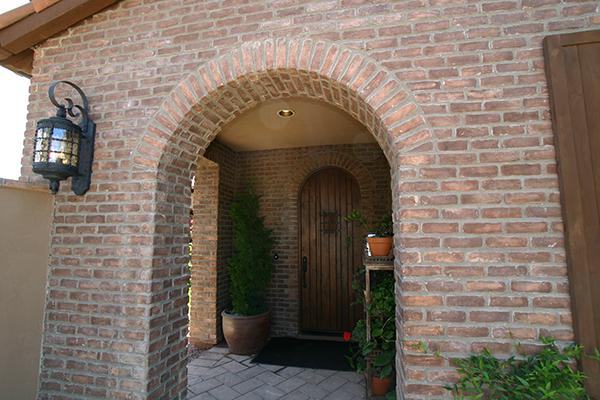 the art of adding brick veneer around an arched alcove pro masonry