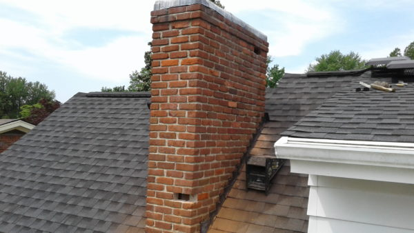 Shown is a spalled brick in a chimney in need of repair.